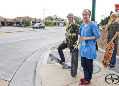 (L-R) Nate Brown, Jordan Brown and Tyler Aldrich wait at the crosswalk as we run to the next skate location. Photo: Talyn Sherer