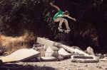 Keeping it  adventurous, with an ollie over some  dilapidated crete.