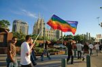 The Gay Pride flag pictured in front of the Mormon Temple symbolizes the two opposing communities in a scene from Cowan's new film.