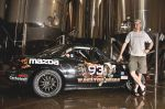 Jon Lee, head brewer at the UBC, stands with his Devastator race car. Photo: Jesse Anderson