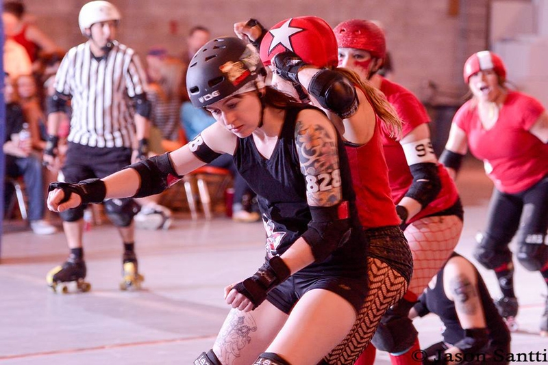 Black Hearts' Scissorella holds the Cherry Bombs ' jammer.