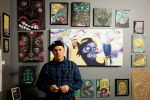 Artist Ryan Worwood poses with his work. Photo by Brent Rowland
