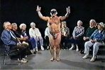 "A masked dancer performs for a group of confused senior citizens on the 1999 Los Angeles cable access show, ""Dancing with Frank Pacholski."" Courtesy of the Found Footage Festival."