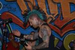 Jake Colatis of The Casualties, strumming and showing off his gnarly head tatoo. Photo: Frank Carroll