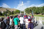 About 200 skaters hiked to the top of the bridge for the final Go Skate Day hill bomb. Photo: Jake Vivori