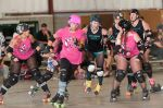 Grand Junction Roller Girls blocking Junction City. Photo: Chris Bojanower