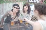 Rusty and Crook Kid Coathanger talk to Esther Merono on the patio at Spider House in Austin for SXSW. Photo: Angela H. Brown