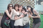 """Can I be in your band?"" SLUG Editorial Assistant Esther Merono surrounded by The Coathangers. Photo: Angela H. Brown"