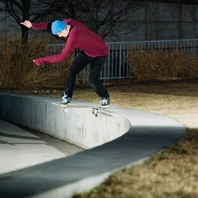 Odeus flow rider Kendall Johnson demonstrates a perfectly executed backside tail slide on a library square.