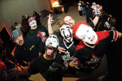 Chaos (far right) and his Juggalo crew showing the camera some mad clown love.