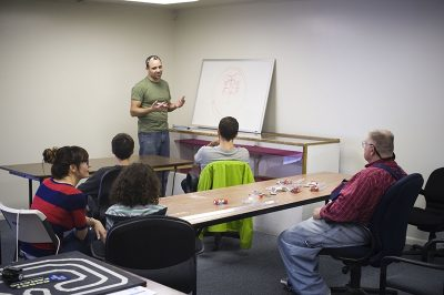 EnjiGo's resident Robot Fanatic, Michael Anderson, began leading a class in July for students of all engineering skill levels, instructing them how to build their own Sumo Bots with an inexpensive materials package.