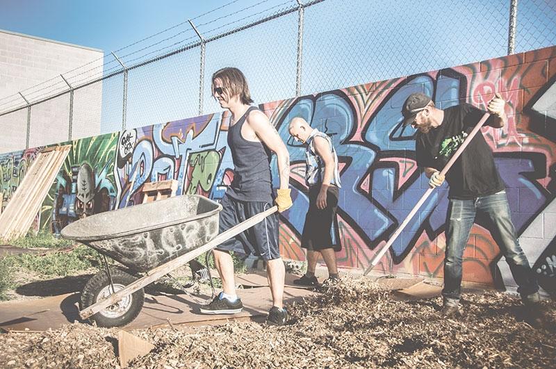 AFLA volunteers (L–R) Jordan Bateman, Jim Rose and Rick Berry hard at work building the Rail Yard Art Garden.