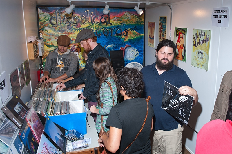 Adam Tye (far right) and his wife Alana Boscan have cultivated a promising record store inside the shipping crates of Granary Row.