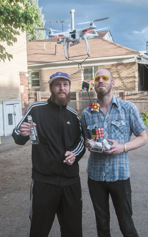 Mike Brown (L) and Jon Larsen (R) are just one Mike Abu short from a perfect threesome to play with their … Rubik's Cubes.
