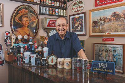 """Carlos Gallegos boasts a comprehensive collection of Utah beer memorabilia, aka """"breweriana."""""""