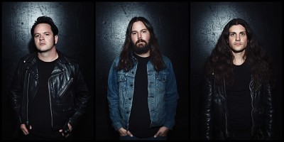 Photo of Jarvis Leatherby, Brent Woodward and Dustin Squires of Night Demon.