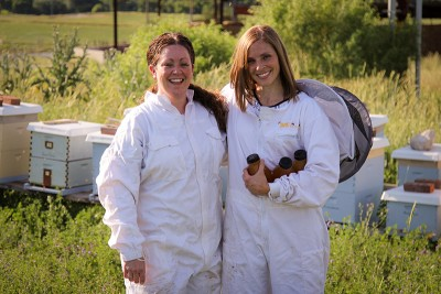 (L–R) 2015 Craft Lake City DIY Fest food vendors Gina Nielson and Aubrey Johnson are purveyors of raw honey and honey-based products.