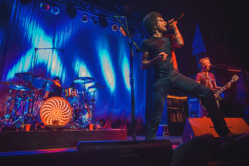 (L–R) Hidden behind the drums founding member Sean Kinney joins William DuVall and original guitarist Jerry Cantrell onstage as they return to Salt Lake City on Monday night. Photo: Talyn Sherer