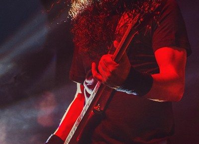 Bassist Mike Inez absorbs the red lights while performing with Alice in Chains. Photo: Talyn Sherer