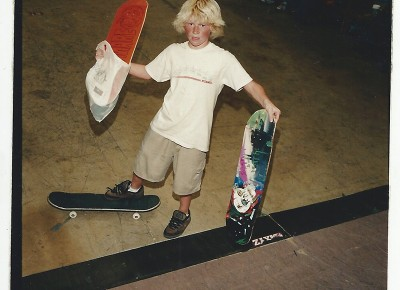 A young Oliver Buchanan shows off his new boards.