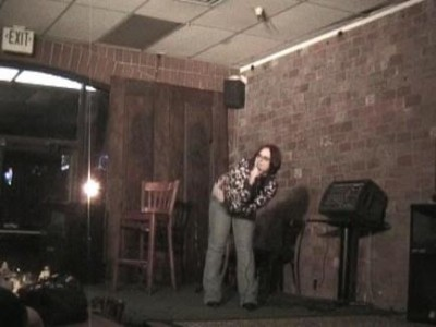 Melissa Merlot performs at a bygone Utah comedy venue—the old Downtown location of Mo's Neighborhood Grill