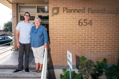 (L–R) Artist Jorge Rojas and Planned Parenthood Association of Utah Director Karrie Galloway stand united in preparation for Planned Parenthood's fundraising gala, The Art of Safe Sex.