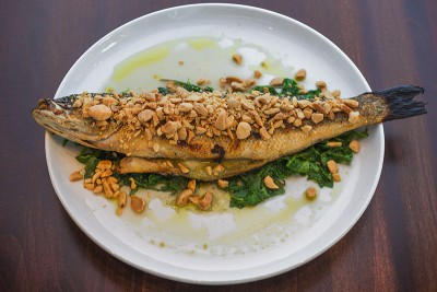Branzino ($30) is a dramatic dish—a whole fish, head to tail, is served atop sautéed greens and covered with marcona almonds.