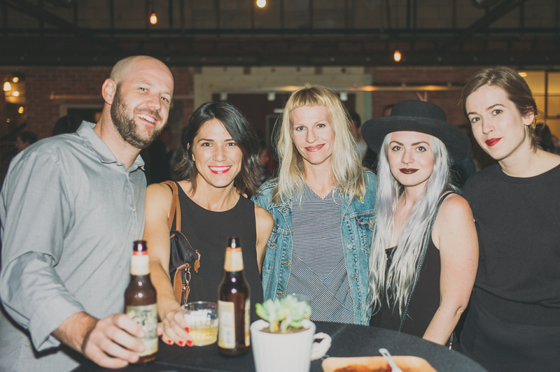 (L-R) Elwood and Leah Hullinger, Nicole Warner, Valori Boss and Eleanor Kramer gathered around one of the many standing tables in Publik's event space. Photo: @clancycoop