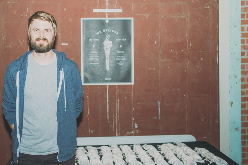 Matt Wigham, who started Big Cartel, stands near goodie bags featuring pins in the shape of a van. Photo: @clancycoop