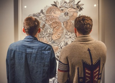 Two lost souls engulf themselves in the intricate maze of beauty created by artist Firelei Báez. Photo: Talyn Sherer