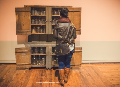 "A woman looks into ""Grandma's Cupboard"" by artists Mel Ziegler and Kate Ericson. Photo: Talyn Sherer"
