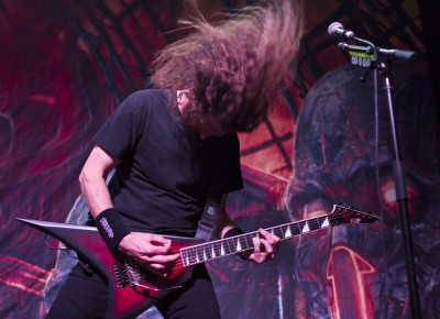Lum furiously bangs his head during Exodus' set. Photo by Madi Smith.