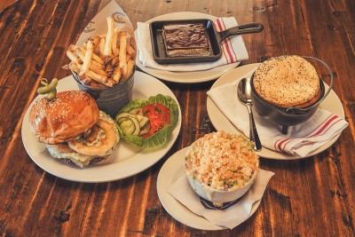 (Clockwise from left) High West Saloon's Burger and Fries, The S'more, Pot Pie and Mac & Cheese are indulgent dishes of High Country Cuisine.