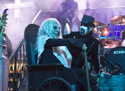 "(L–R) Grandma and King Diamond roll onto the stage during ""Out From the Asylum."" Photo by Madi Smith."