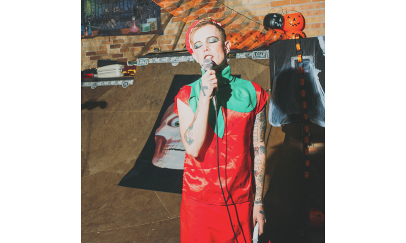 "Robin Banks (dressed as a strawberry) sings ""We Got the Beat"" as The Go-Go's (Foster Body). Photo: Tyson Call @clancycoop"