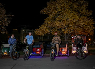 Salt City Cycle Cab drivers line up to haul Garth Brooks fans after his Halloween show at the Vivint Smart Home Arena. Photo: John Barkiple