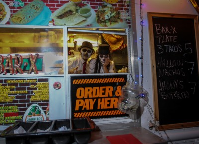 The Bar X Taco Cart servers wore painted sugar skulls as they served late night snacks. Photo: John Barkiple