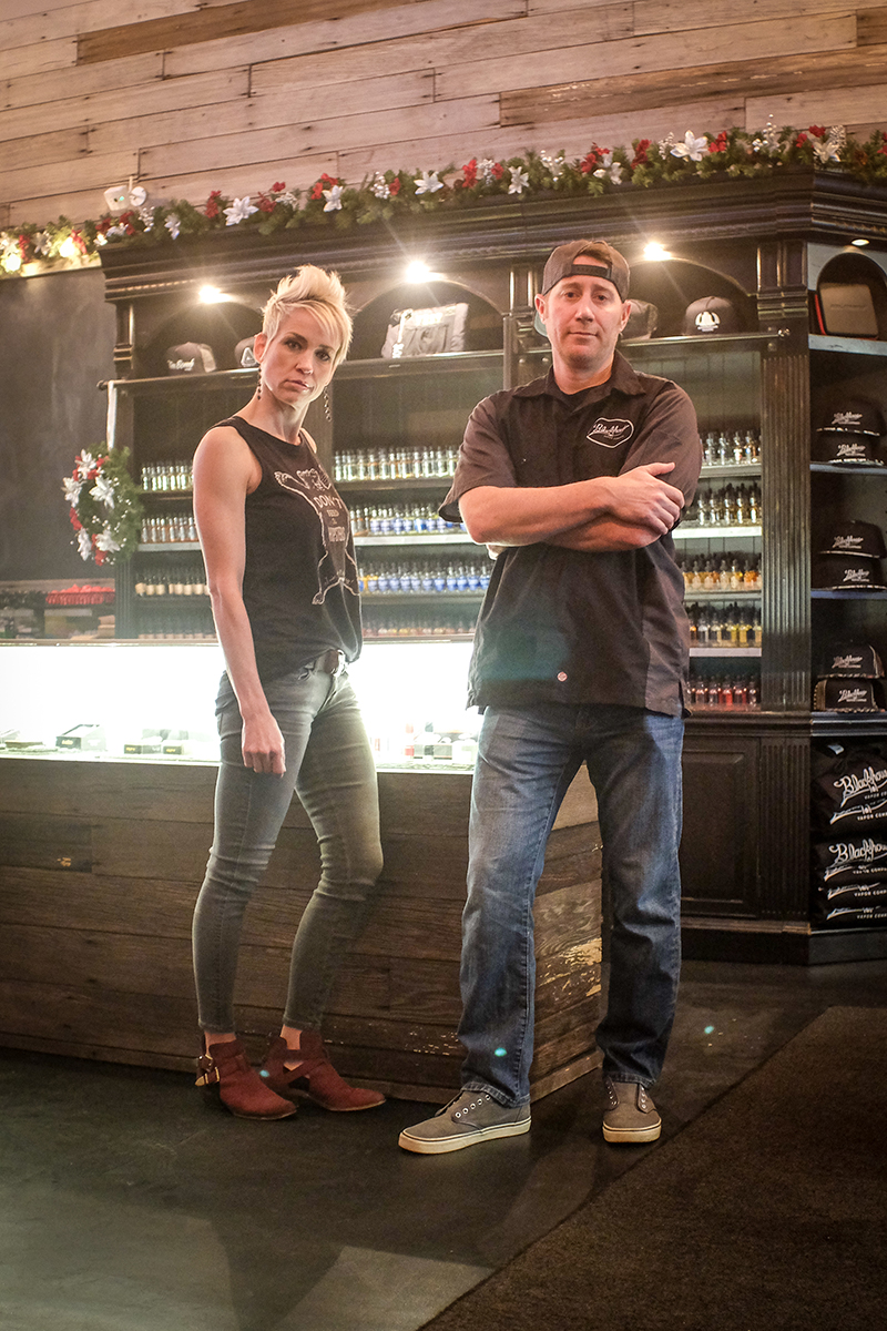 (L–R) Holly and Mike Berry aim to shape a welcoming, classy atmosphere at Blackhouse Vapor Company.