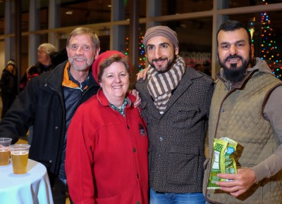 (L-R) Bob Plachta, Nancy Carlson, Omar Abou-Ismail and Sam Aziz take a break from the chilly plaza for beers and snacks upstairs at the Gallivan Center. PopArt Popcorn offered seven flavors at a popcorn bar. Learn more at the popartsnacks.com website. Photo: John Barkiple