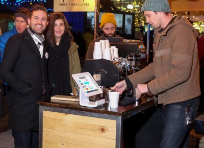 (L-R) Chase Murdock and Stephanie Petry order coffee from Nick Bryce at the Three Pines Coffee booth at KRCL's 2015 Polar Jubilee. Photo: John Barkiple