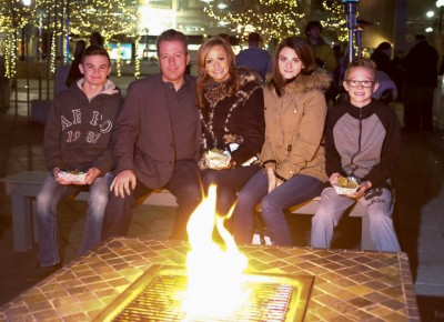 (L-R) Landen Hamblin, Paul Duane, Shayla Porter, Laurel Hamblin and Porter Hamblin enjoy a snack and a fire at KRCL's Polar Jubilee. Photo: John Barkiple