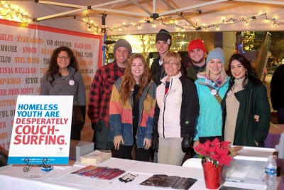 VFA volunteer DeAnn Zebelean (center, in a white jacket) is surrounded by VFA and KRCL youth radio DJs at the VFA clothing donation table for homeless youth. Proceeds from the Polar Jubilee benefited VFA's homeless youth programs. Check voaut.org/home4teens to learn more or donate. Photo: John Barkiple