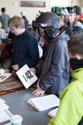 Contestant Colton Cravens gets his number as the line gets longer for registration. Photo: Niels Jensen