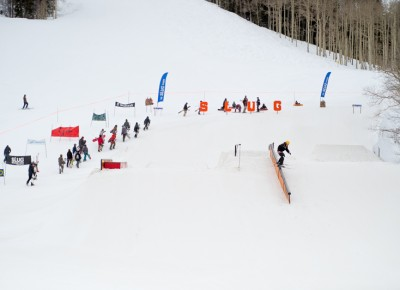 The first riders head up the hill for practice runs before the 17 & Under contests get under way. Photo: Niels Jensen