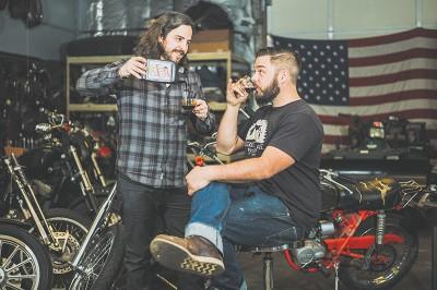 (L–R) Davy Bartlett and Nik Garff of Suicide Lane Cycles set up their custom motorcycle workshop in Salt Lake in 2014.