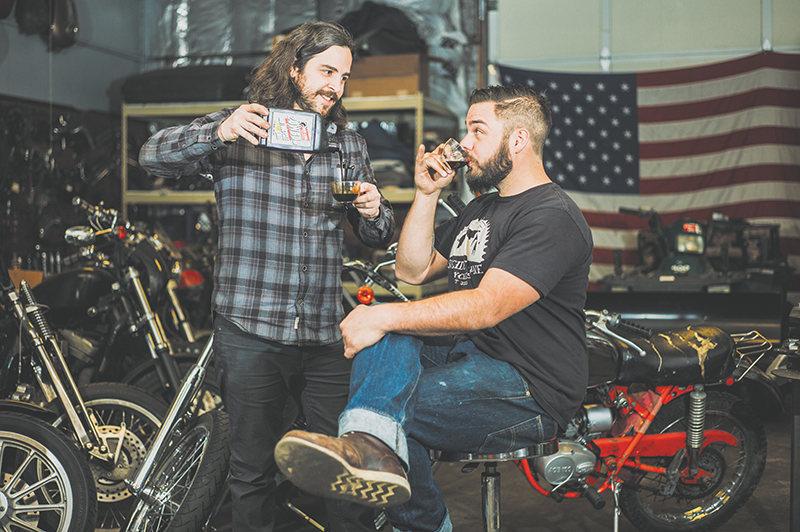 (L–R) Davy Bartlett and Nik Garff of Suicide Lane Cycles set up their custom motorcycle workshop in Salt Lake in 2014.
