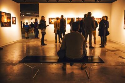 Inside the David Brothers exhibit, an art aficionado takes a seat to soak up the pure talent surrounding him. Photo: talynsherer.com