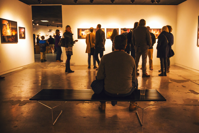 Inside the David Brothers exhibit, an art aficionado takes a seat to soak up the pure talent surrounding him. Photo: talynsherer.com