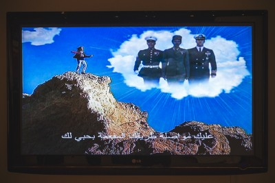 """A personal favorite came from artist Christoph Buchel's video titled """"America We Stand As One."""" Featuring a wide array of overly patriotic lyrics and paraphernalia complemented by Arabic subtitles, this film had it all. Photo: talynsherer.com"""