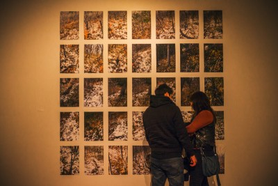 """A couple gets intimate as they cuddle up to Paul Crow's """"Trail Two, Autumn"""" display. Photo: talynsherer.com"""